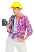 Serious handy woman with a power drill — Stok fotoğraf