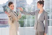 Angry businesswoman pointing at her rival — Stock Photo