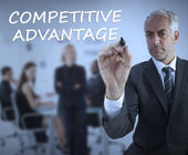 Sophisticated businessman writing competitive advantage — Stock Photo