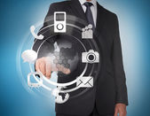 Businessman selecting icons on a hologram — Stock Photo