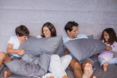Family having fun together on bed — Stock Photo