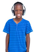 Smiling boy listening to music — Stock Photo