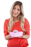 Blonde woman receiving a gift — Stock Photo