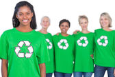 Team of female environmental activists smiling at camera — Stock Photo