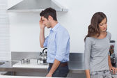 Couple sulking at each other in the kitchen — Stock Photo