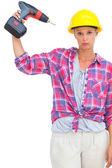 Blonde handy woman holding a power drill — Stok fotoğraf