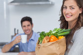 Woman with groceries bag — Stock Photo