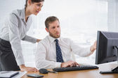 Businessman showing his colleague something on computer — Stock Photo