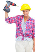 Attractive handy woman holding a power drill — Stok fotoğraf