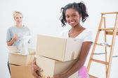 Smiling young housemates moving into new home — Stock Photo