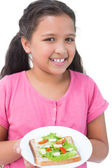 Little girl showing her sandwich to camera — Stock Photo