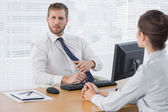 Businessman meeting with a colleague at his desk — Stock Photo