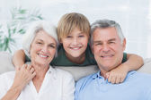 Grandson embracing his grandparents — Stock Photo