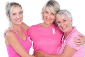 Women wearing pink tops and ribbons for breast cancer — Stock Photo