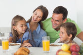 Parents having breakfast with their children — Stock Photo