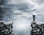 Businessman thinking at the edge of a cliff — Stockfoto