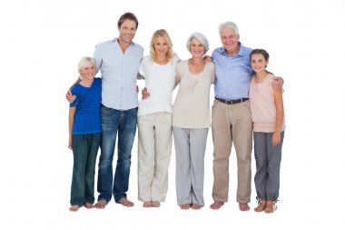 Family standing against a white background