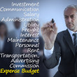 Sophisticated businessman writing expense terms — Stok fotoğraf