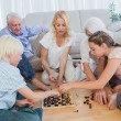 Extended family playing chess — Stock Photo #28060105