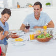 Family eating pasta and salad — Stock Photo #28060211