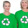 Stock Photo: Two women wearing green recycling tshirts