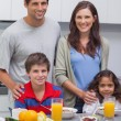 Smiling family at breakfast — Stock Photo