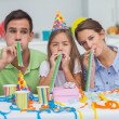 Family playing with party horns — Stock Photo