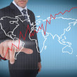 Businessman selecting a world map — Stock Photo #28060569