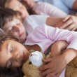 Cute family napping together — Stock Photo #28060591