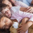 Cute family napping together — Stock Photo