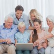 Extended family sitting on sofa — Stock Photo #28060667