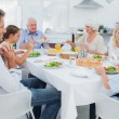 Stock Photo: Extended family at the dinner table