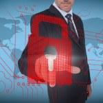 Businessman selecting a red padlock — Stock Photo