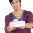 Young man offering a gift — Stock Photo
