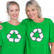 Stock Photo: Two smiling women wearing green recycling tshirts