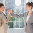 Annoyed businesswoman pointing at her rival — Stock Photo