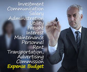 Sophisticated businessman writing expense terms — Stock Photo