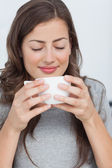 Woman waking with the scent of coffee — Stock Photo
