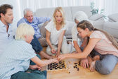 Extended family playing chess — Stock Photo