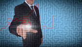 Businessman selecting a labyrinth — 图库照片