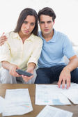 Worried couple doing their accounts — Stock Photo