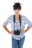 Young woman with camera put hands on her hips — Stok fotoğraf