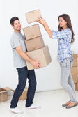 Woman giving boxes to her husband — Stock Photo