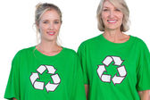 Two women wearing green recycling tshirts — Stock Photo
