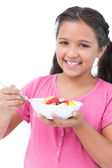 Little girl eating fruit salad — Stock Photo