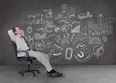 Empresario relajado, sentado en una silla — Foto de Stock