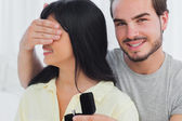 Smiling man about to propose hiding eyes of his girlfriend — Stock Photo