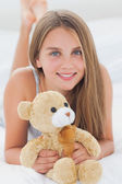 Young girl holding a teddy bear — Stock Photo