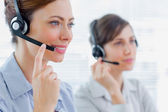 Call centre agents at work — 图库照片