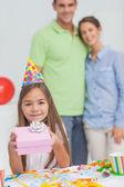 Little girl holding a birthday gift — Stock Photo